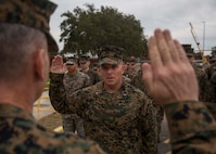 U.S. Marine Corps Chief Warrant Officer Matthew Kessinger, personnel officer of 6th Marine Corps District recites the oath of office during his promotion to chief warrant officer five aboard Marine Corps Recruit Depot Parris Island, South Carolina, Dec. 19, 2018. Kessinger, a native of Louisville, Kentucky, has currently served 28 years in the Marine Corps. (U.S. Marine Corps photo by Lance Cpl. Jack A. E. Rigsby)