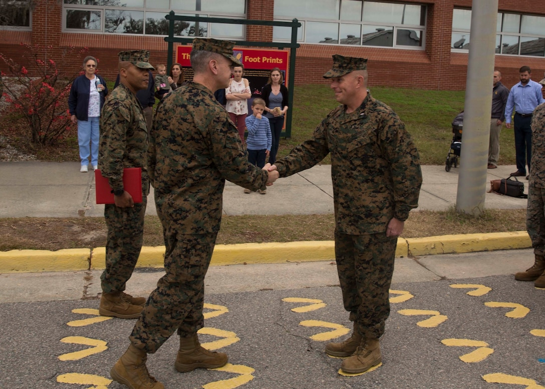 U.S. Marine Corps Chief Warrant Officer Matthew Kessinger, personnel officer of 6th Marine Corps District, right, shakes hands with Col. William C. Gray, commanding officer of 6th MCD, during his promotion to chief warrant officer five aboard Marine Corps Recruit Depot Parris Island, South Carolina, Dec. 19, 2018. Kessinger, a native of Louisville, Kentucky, has currently served 28 years in the Marine Corps. (U.S. Marine Corps photo by Lance Cpl. Jack A. E. Rigsby)