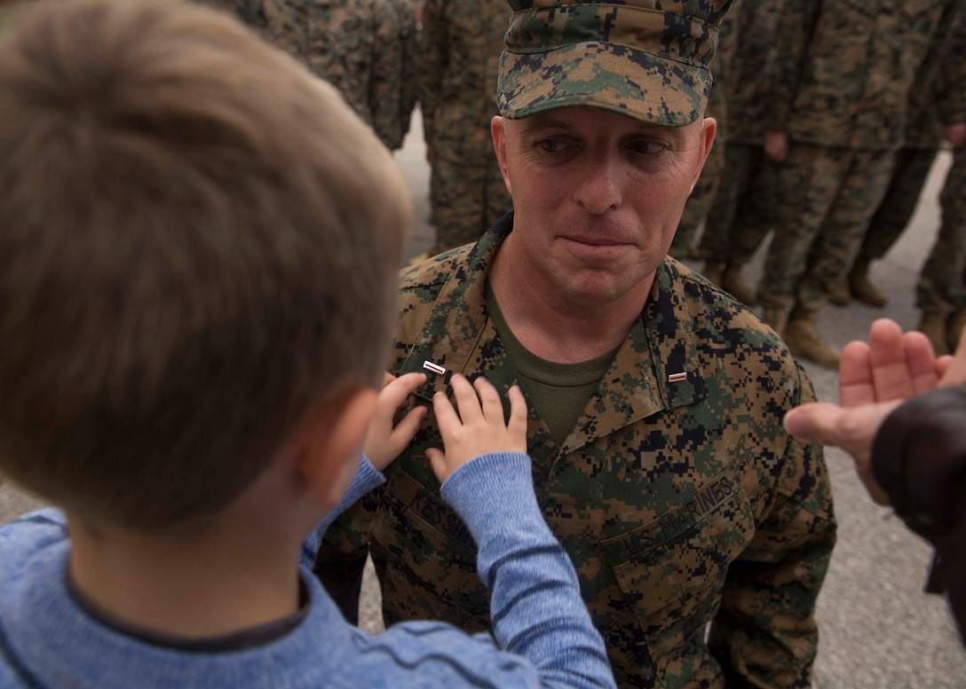 Nicholas Kessinger pins the rank of chief warrant officer five onto Chief Warrant Officer Matthew Kessinger, personnel officer of 6th Marine Corps District, at Marine Corps Recruit Depot Parris Island, South Carolina, Dec. 19, 2018. Kessinger, a native of Louisville, Kentucky, has currently served 28 years in the Marine Corps. (U.S. Marine Corps photo by Lance Cpl. Jack A. E. Rigsby)