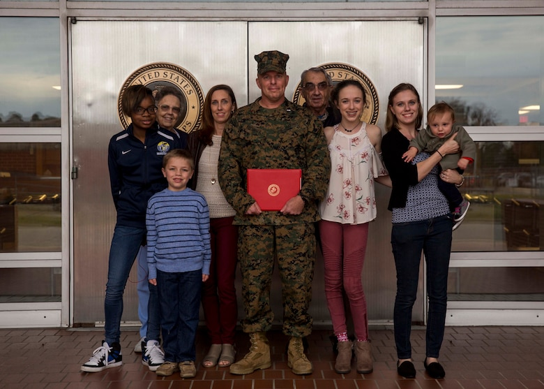 U.S. Marine Corps Chief Warrant Officer Matthew Kessinger, personnel officer of 6th Marine Corps District, poses for a photo with his family after his promotion to chief warrant officer five aboard Marine Corps Recruit Depot Parris Island, South Carolina, Dec. 19, 2018. Kessinger, a native of Louisville, Kentucky, has currently served 28 years in the Marine Corps. (U.S. Marine Corps photo by Lance Cpl. Jack A. E. Rigsby)