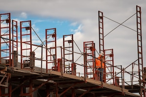 A masonry worker with the Army Corps of Engineers walks across scaffolding on the construction site of the 56th Communications Squadron building, Jan. 14, 2019 at Luke Air Force Base, Ariz.