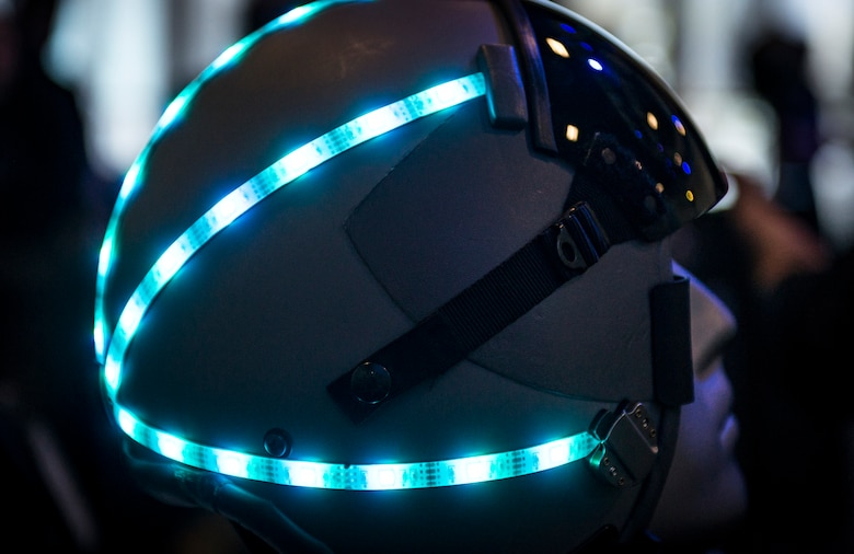 A helmet sits turned on at a booth during AFWERX Helmet Challenge at the Enclave Las Vegas, Nev., November 14, 2018. The purpose of AFWERX Las Vegas is to solve problems for the Air Force by getting entrepreneurs and innovators to come together to brain storm ideas. (U.S. Air Force photo by Airman 1st Class Bryan T. Guthrie)