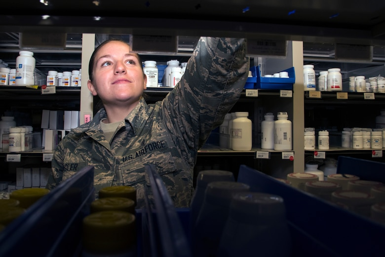 U.S. Air Force Airman 1st Class Sydney Klinger, a 6th Medical Support Squadron pharmacy technician, locates a prescription bottle at MacDill Air Force Base, Fla., Jan. 11, 2019.