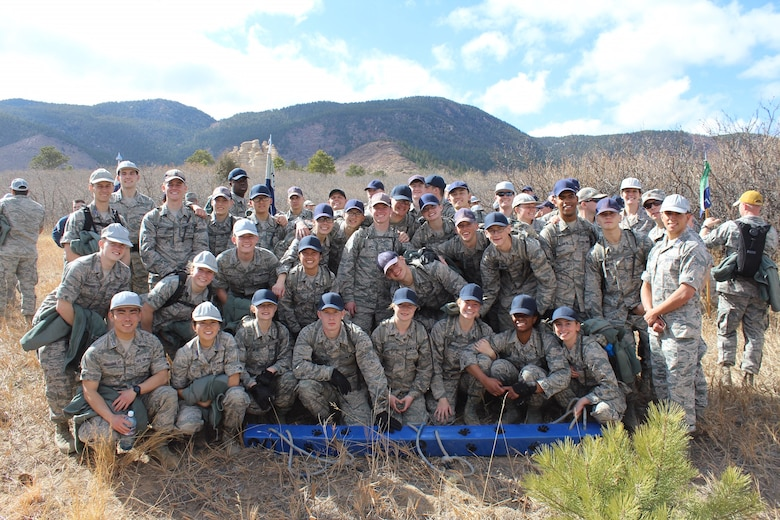 Maj. Brian Low, Air Officer Commanding, poses for a photo with his cadets as part of the U.S. Air Force Academy's Recognition in Colorado, March 2017. Recognition is the formal three-day finale of the fourth-class year (the freshman year at traditional universities) when the cadets are recognized as upper-class cadets and are allowed to wear the Prop and Wings insignia on their flight caps. During his time as and AOC, Low was responsible for 115 cadets and their military training to prepare them to be officers.