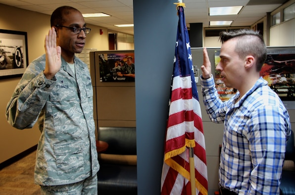 "At left, performing the oath of office for an incoming American Airman, Adam Wait, is Col. Lance Turner, the commander of the 932nd Mission Support Group.  Wait will be heading out to officer training and then medical schools as he enters the 932nd Aeromedical Evacuation Squadron as a flight nurse.  He said, ""I believe this will help further my career and it's always been a personal goal to join the military.""  The special event in his young military history took place on January 16, 2019, at the 932nd Airlift Wing headquarters, located at Scott Air Force Base, Illinois.   Others interested in reserve opportunities can call the recruiting department at (618)