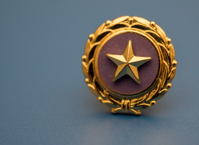 The Gold Star Family Member lapel pin was presented to U.S. Navy Commander Kerry Beasley at Joint Base Langley-Eustis, Virginia, Jan. 9, 2019 by 633rd Air Base Wing Commander, Colonel Sean K. Tyler.