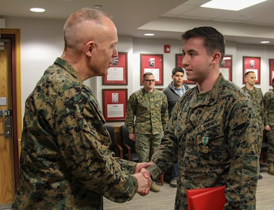 CAMP HUMPHREYS, Republic of Korea – Sgt. Barry B. Smith, G6 systems administrator, receives the Navy and Marine Corps Achievement Medal and a Certificate of Appreciation from Maj. Gen. Patrick J. Hermesmann, U.S. Marine Corps Forces Korea commander, here, Jan. 16. Smith received the Navy and Marine Corps Achievement Medal for his contribution to the unit's mission accomplishment during his time here and the Certificate of Appreciation for four years of faithful service to the Marine Corps. (Official U.S. Marine Corps photos by Sgt. Nathaniel Hanscom/Released)