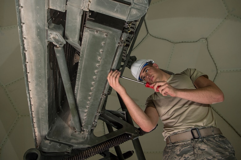 Senior Airman Collin Tully, 727th Expeditionary Air Control Squadron, Detachment 3 radar maintainer, conducts routine maintenance on a transportable radar system (TPS-75) Jan. 14, 2019, at Al Udeid Air Base, Qatar. The 727th EACS consists of a team of 23 Airmen from seven different Air Force Specialty Codes. Together, they ensure TPS-75 radar systems are prepared to identify any aircraft within a 240 nautical mile range of Al Udeid. (U.S. Air Force Tech. Sgt. Christopher Hubenthal)