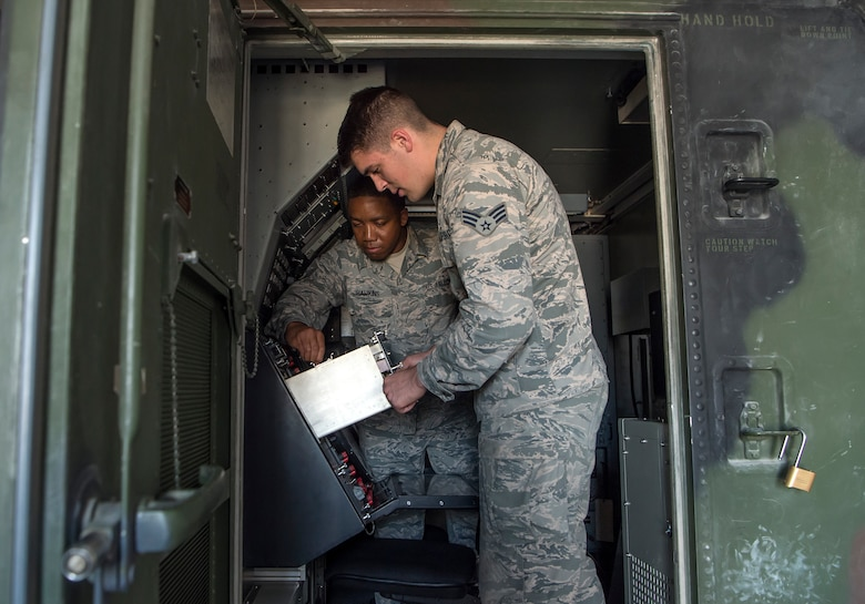 Senior Airman Collin Tully, foreground, 727th Expeditionary Air Control Squadron, Detachment 3 (EACS DET 3) radar maintainer, and Staff Sgt. Matthew Hawkins, 727th EACS DET 3 radar maintenance NCO in charge, conduct routine maintenance in the radar shelter of a transportable radar system (TPS-75) Jan. 14, 2019, at Al Udeid Air Base, Qatar. The 727th EACS consists of a team of 23 Airmen from seven different Air Force Specialty Codes. Together, they ensure TPS-75 radar systems are prepared to identify any aircraft within a 240 nautical mile range of Al Udeid. (U.S. Air Force Tech. Sgt. Christopher Hubenthal)