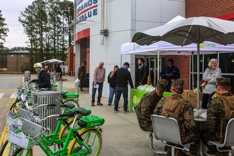 Representatives from Lime hold an information session outside of the main exchange on Marine Corps Air Station New River, Jan. 12, 2019. MCCS Lejeune-New River and Lime, a bicycle-sharing company, worked together to bring an environmentally friendly and inexpensive transportation alternative for Marines who lack vehicle transportation or wish to save money. (U.S. Marine Corps photo by Cpl. Jon Sosner)