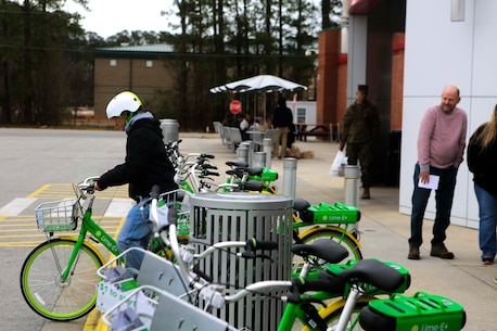 Representatives from Lime takes one of their bikes on for a ride outside of the main exchange on Marine Corps Air Station New River, Jan. 12, 2019. MCCS Lejeune-New River and Lime, a bicycle-sharing company, worked together to bring an environmentally friendly and inexpensive transportation alternative for Marines who lack vehicle transportation or wish to save money. (U.S. Marine Corps photo by Cpl. Jon Sosner)