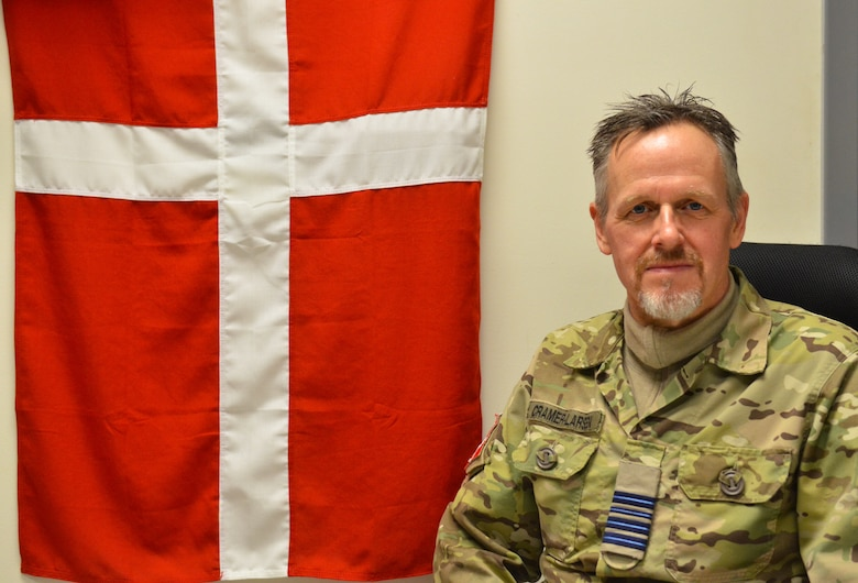 Royal Danish Air Force Lt. Col. Lars Cramer-Larsen, RDAF chief coalition strategist, sits in his office in the Combined Air Operations Center  at Al Udeid Air Base, Qatar, Jan. 16, 2019. Cramer-Larsen has hosted several informal lectures about the Middle East throughout the base to provide his expertise and research to coalition audiences. (U.S. Air Force Photo by Senior Airman Travis Beihl)