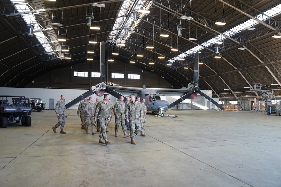 People touring an aircraft hangar.