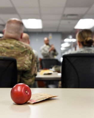 Examples of healthy food choicecs sit on a desk during the Better Nutrition segment of the Better Body. Better Life. course at the Pittsburgh International Airport Air Reserve Station, Pa., June 5, 2019. The course is taught by Tech. Sgt. Bryson Manker, diet therapist with the 911th Aeromedical Staging Squadron, who hopes to help others gain a better understanding of overall nutrition. (U.S. Air Force photo by Staff Sgt. Beth Kobily)