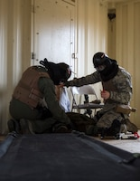 U.S. Air Force Airmen from the 109th Aeromedical Evacuation Squadron, check the simulated patient for additional injuries at the Arden Hills Army Training Site in Arden Hills, Minn., Nov. 16, 2018.