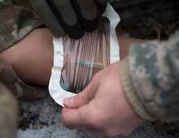 U.S. Army Staff Sgt. Ryan Kelly, 2nd Battalion (Modular Training), 175th Regiment (Regional Training Institute), places a tegaderm onto an intravenous site at the Arden Hills Army Training Site in Arden Hills, Minn., Nov. 16, 2018.