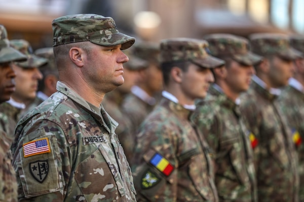 Cpt. William Carter stands alongside multinational Soldiers during the Ukrainian Independence Day parade in Kyiv, Aug. 24, 2018.