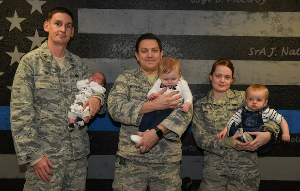 U.S. Air Force Maj. Brian Rutt, 423rd Security Forces commander, holds his baby with his defender team at RAF Alconbury, United Kingdom, Jan. 15, 2019. (U.S. Air Force photo by Airman 1st Class Jennifer Zima)