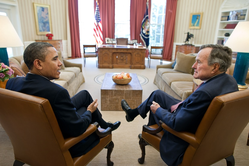 President Barack Obama meets with President George H.W. Bush in Oval Office, February 15, 2011