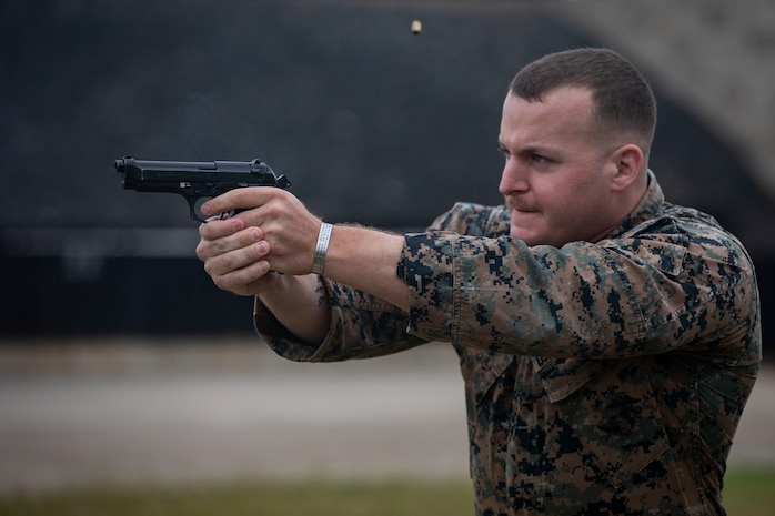U.S. Marine Corps Staff Sgt. Brandon Brooks, an air traffic controller with Marine Corps Air Station Kaneohe Bay, fires a M9 Berretta Pistol at targets during the Marine Corps Marksmanship Competition, Pacific (MCMCP) at Kaneohe Bay Range Training Facility, Marine Corps Base Hawaii, Jan. 14, 2019. The MCMCP is one of four division matches throughout the U.S. Marine Corps in which U.S. Service members and the Pacific's best shooters participate in a small arms marksmanship competition each year. Each course of fire is unique utilizing rifle and pistol while being timed to select the top shooters. (U.S. Marine Corps photo by Sgt. Jesus Sepulveda Torres)