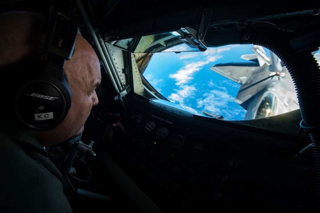 U.S. Air Force Reserve Master Sgt. Ken Clonts, a 756th Air Refueling Squadron in-flight refueler, conducts aerial refueling with an F-22 Raptor from the 199th Fighter Squadron near Joint Base Pearl Harbor-Hickam, Hawaii, Jan. 15, 2019.