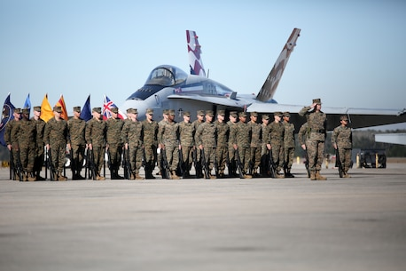 Marines stand in formation during VMFA-115's change of command ceremony aboard Marine Corps Air Station Beaufort, Jan. 11. During the ceremony Lt. Col. Jonathan Curtis relinquished command of the squadron to Lt. Col. Edmund Hipp