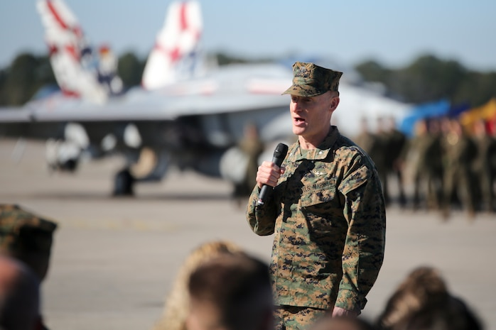 """Lt. Col. Edmund B. Hipp addresses a crowd during VMFA-115's change of command ceremony aboard Marine Corps Air Station Beaufort, Jan. 11. During the ceremony Lt. Col. Jonathan Curtis relinquished command of the """"Silver Eagles"""" to Hipp."""