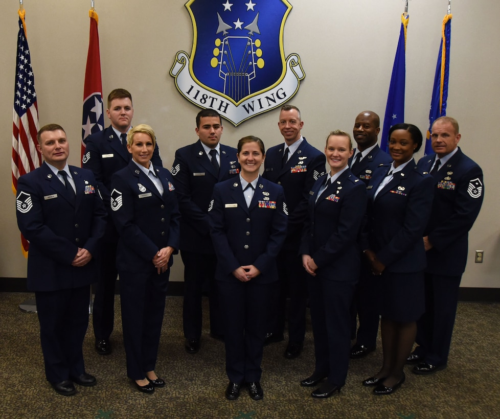 Airmen from the 118th Wing pose for a photo after receiving their Community College of the Air Force diplomas on January 13, 2019 at Berry Field Air National Guard Base, Nashville, Tennessee.
