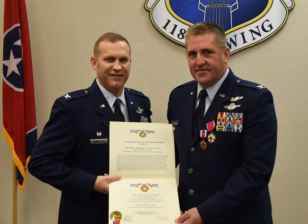 U.S. Air Force Col. Jeff Slayton, right, former commander of the 118th Operations Group, Tennessee Air National Guard, receives the distinguished service medal from Col. Keith Allbritten, commander of the 118th Wing, on January 12, 2019 at Berry Field Air National Guard Base, Nashville, Tennessee.