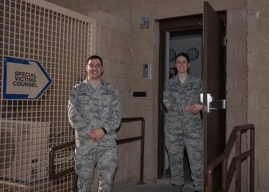 Capt. Matthew Pellegrine, 49th Wing special victims' counsel, and Tech. Sgt. Rochelle Schwarz, 49th Wing special victims' paralegal, pose outside the new Special Victims' Counsel Office, Jan. 1, 2019, on Holloman Air Force Base, N.M. The SVC offers confidential legal advice to victims of an offense under the Uniform Code of Military Justice. (U.S. Air Force photo by Airman Autumn Vogt)