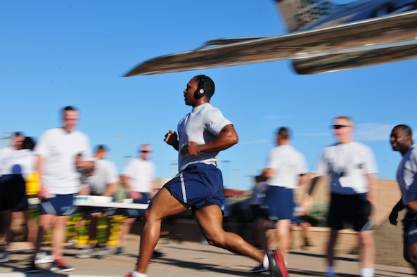 Airmen from the 161st Air Refueling Wing participate in their Air Force Physical fitness Test's 1.5-mile run. Rowing, biking, swimming and elliptical training can all develop endurance and have a positive impact to an Airman's PFT score. (Courtesy photo by 161st Air refueling Wing)
