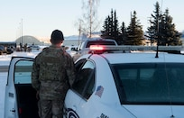 U.S. Air Force Staff Sgt. Evan Romero, a 673d Security Forces Squadron operations support noncommissioned officer, simulates pulling over an impaired driver at Joint Base Elmendorf-Richardson, Alaska, Jan. 15, 2019. For someone struggling with drugs or alcohol problems, JBER offers multiple programs and resources such as the Alcohol Drug Abuse Prevention and Treatment (ADAPT) program and Army Substance Abuse Program (ASAP), which can be reached at 580-2181 and 384-1412 respectively. Also, Joint Base Against Drunk Driving (JBADD), which offers rides to people who have been drinking and need a safe drive home, can be reached at 907-384-7433.