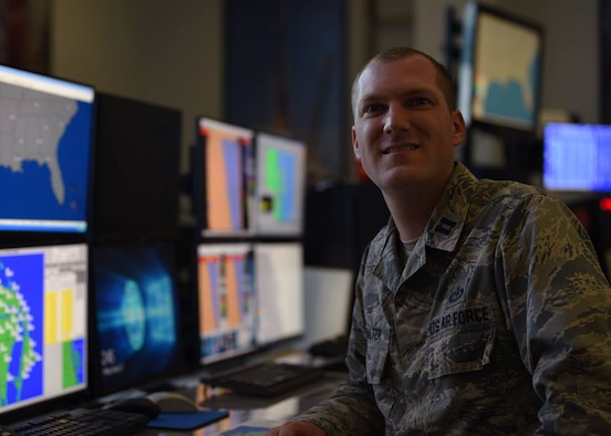 Capt. Matthew Walter, 45th Weather Squadron Airfield and Range Weather Operations flight commander, poses for a photo in the Morrell Operations Center on Jan. 11, 2019, at Cape Canaveral Air Force Station, Fla. Walter is a weather officer who is passionate about severe weather awareness due to experiencing a tornado on his family farm as a child. (U.S. Air Force photo by Airman 1st Class Zoe Thacker)