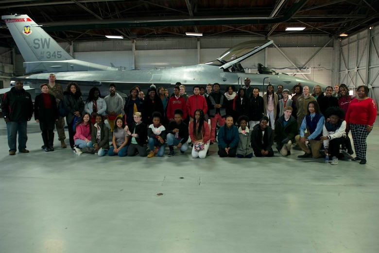 Students from five local middle schools stand in front of an F-16 Fighting Falcon at Shaw Air Force Base, S.C., Jan. 11, 2019.