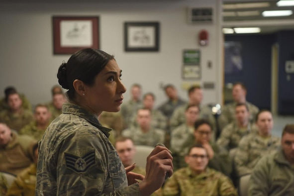 Staff Sgt. Symphony Leyk, 5th Force Support Squadron Airman Leadership School Instructor, shares memories while instructing her students at Minot Air Force Base, N.D., Jan. 15, 2019,. Airmanship, standards, discipline and self-awareness are a few topics covered throughout the five-week ALS course. (U.S. Air Force photo by Airman 1st Class Heather Ley)