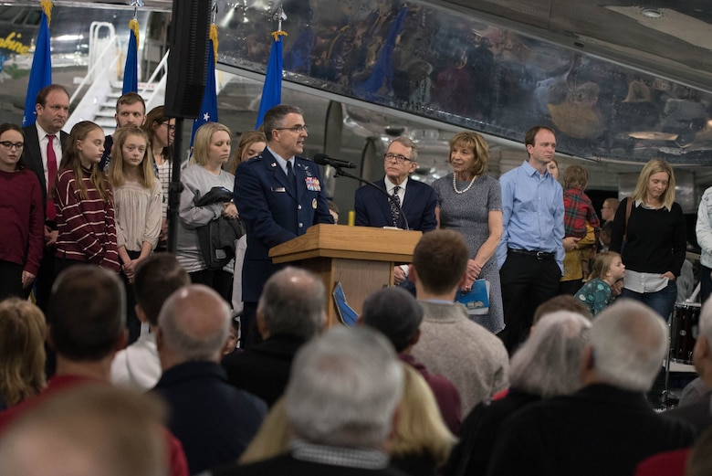 U.S. Air Force Maj. Gen. William Cooley, commander, Air Force Research laboratory, gives the opening remarks for the Science, Discovery and Family Fun Event held at the National Museum of the U.S. Air Force, Wright-Patterson Air Force Base, Jan. 13. Joining the general was Ohio Gov. Mike DeWine and his wife Fran.