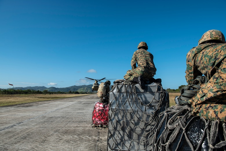 Agents from Panama's National Border Service wait to load slings onto a U.S. Army CH-47 Chinook headed to the Darien Province in the Republic of Panama, Jan. 11, 2019.