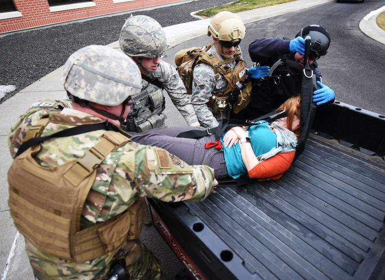 Members of the 92nd Security Forces Squadron and 92nd Civil Engineer Squadron fire department, aid a victim during an active shooter exercise at Fairchild Air Force Base, Washington, Jan. 16, 2019.