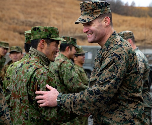 U.S. Marines with 2nd Battalion, 23rd Marine Regiment, currently assigned to 3rd Marine Division, and Soldiers with the Japan Ground Self-Defense Force, shake hands with their counter parts after the opening ceremony for exercise Forest Light 19.1, in Hijyudai Maneuver Area, Japan, on Dec. 7, 2018. This is the first time in 13 years that the reserve unit 2/23 is active and deployed to the Indo-Pacific region. They will conduct multiple bilateral training exercises in various countries to improve their combat readiness and strengthen international relationships. (U.S. Marine Corps photo by Lance Cpl. Christine Phelps)