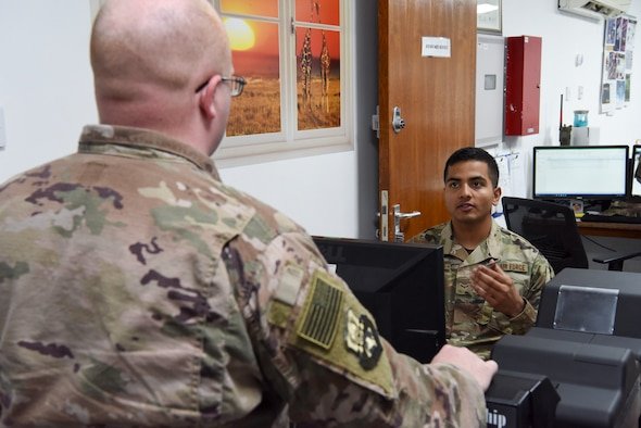Airman 1st Class Anmol Adhikari, 380th Expeditionary Force Support Squadron PERSCO customer support technician, assists a customer with getting a new identification card Jan. 17, 2019 at Al Dhafra Air Base, United Arab Emirates.