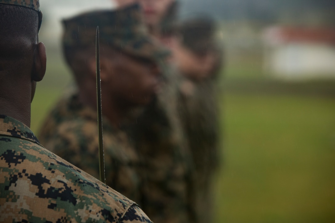 Sgt. Kirk Broxton looks over his Marines during a drill competition Jan. 16, 2019 at Roberts Field, Camp Kinser, Okinawa, Japan. Close order drill is conducted by the Navy and Marine Corps to teach simple formations, discipline and small unit leadership. This is the first drill competition Supply Battalion, Combat Logistics Regiment 35 has hosted and it will be held quarterly.