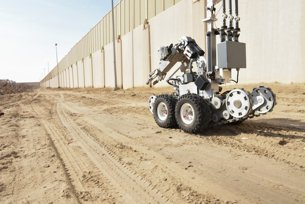 The 380th Expeditionary Civil Engineer Squadron Explosive Ordinance Disposal flight send in their robot to evaluate an area during a joint training event Jan. 15, 2019 at Al Dhafra Air Base, United Arab Emirates.