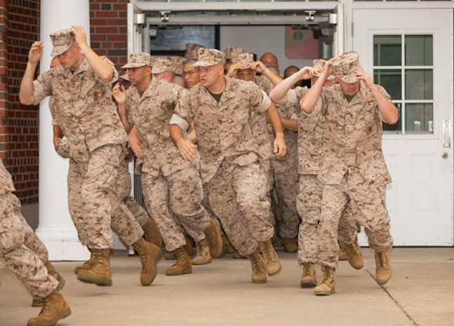 U.S. Marine candidates assigned to the Officer Candidates School undergo their initial brief at Marine Corps Base Quantico, Va
