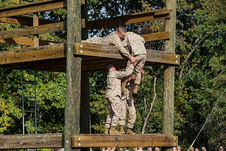 U.S. Marine officer candidates with the Officer Candidate School , Delta Company, participate in the Confidence and Tarzan courses at Marine Corps Base Quantico, Va. The mission of OCS is to educate and train officer candidates in order to evaluate and screen individuals for qualities required to become commissioned as a Marine Corps Officer.