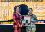 Chenelle Jones is presented a memento of appreciation by Defense Logistics Agency Land and Maritime Chief of Staff Air Force Col. Janette Ketchum. Jones provided the keynote remarks during the 2019 Dr. Martin Luther King, Jr. program Jan. 16 in the Defense Supply Center Columbus Operations Center Auditorium. Jones is the lead Criminal Justice Administration Faculty at Franklin University.