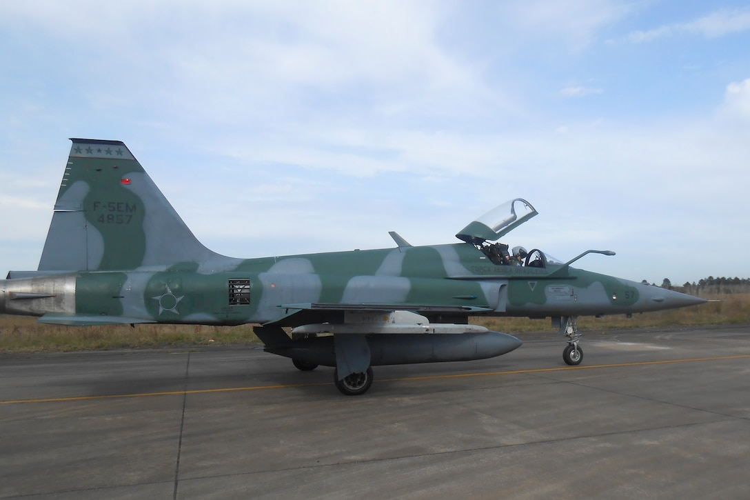An F-5EM Tiger II aircraft belonging to the Brazilian Air Force Força Aérea Brasileira sits on a runway Aug. 2 at Canoas Air Force Base, Canoas, Brazil. Members of the U.S. Air Force International Engine Management Program, based at Tinker Air Force Base, visited Brazil July 27-Aug. 11 to help the ally create a standardized engine for the aircraft and reactivate and correlate engine test cells.