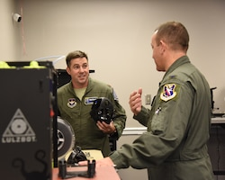 Maj. Ryan Brewer, 14th Flying Training Wing director of innovation, speaks to Col. Derek Stuart, 14th Operations Group commander, during the Spark Cell grand opening Oct. 19, 2018, on Columbus Air Force Base, Mississippi. The need of innovation at Columbus AFB led to a partnership with the 333rd Training Squadron at Keesler AFB, Mississippi, to create new processes and contribute different concepts.  (U.S. Air Force photo by Melissa Doublin)