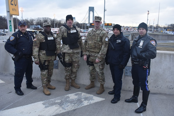 New York National Guard Soldiers of Joint Task Force Empire Shield stand with Triburough Bridge and Tunnel Authority officers and State Troopers, at the Verrazano Bridge, Staten Island, N.Y., Jan. 10, 2019. Soldiers and Troopers were conducting Operation Catch-All, a security operation to prevent terrorism in New York City and the Triburough area.