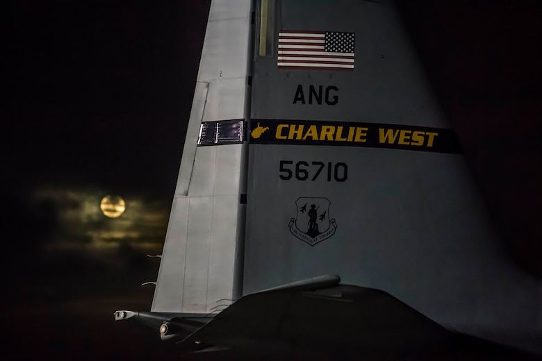 A C-130 Hercules assigned to the 130th Airlift Wing, McLaughlin Air National Guard Base, Charleston, W.Va. awaits takeoff to deliver supplies to Puerto Rico, Oct. 5, 2017
