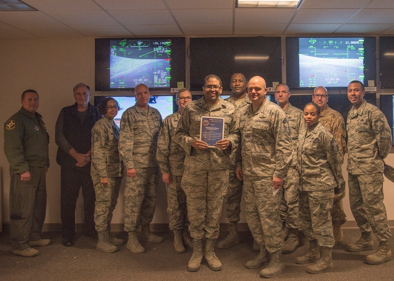 Staff Sgt. Reginald House, Remotely Piloted Aircraft sensor operator instructor, receives the Chief's Choice Award from Chief Master Sgt. Rick Marston, 49th Operations Group superintendent, Jan. 17, 2019, on Holloman Air Force Base, N.M. Holloman's Chiefs Group has a monthly recognition program titled Chief's Choice Award. Every month, a chief has the honor of choosing a deserving Airman for an outstanding act or for continuous oustanding performace. (U.S. Air Force photo by Airman 1st Class Kindra Stewart)